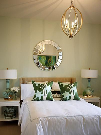 A gorgeous bedroom with a stunning pair of turquoise lamps.