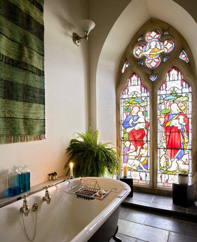 This may be my dream bathroom! I've seen a lot of church conversions in my time and most fall flat on dealing with such a large interior space. Here the layout keeps all the lovely original features like stained glass windows and the amazing timber roof structure but also matches the theatre of the space particularly the bedroom in the apse of the original church, separated from the rest by an epic pair of velvet curtains…