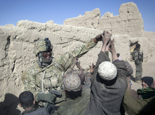 A U.S. soldier gave candy to children while he was on patrol in Kandahar Province, Afghanistan, Wednesday.