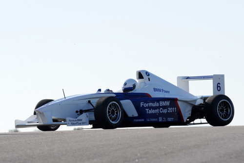 "This is me in my Formula BMW at the Circuito Monteblanco in Spain. I am waiting for my German instructors to give me the ""go-ahead"". When I get the thumbs-up, I'll dump the clutch, reach 100km/h in less than 4 seconds, reach 5th gear, brake hard, downshift from 5th to 2nd while balancing the car with the toe-and-heel technique through each shift, turn-in, apex, and accelerate out the corner without losing the back end of the car. This all happens in about 10 seconds. My efforts are then analysed and evaluated by the BMW instructors who will score me and give me advice on how to improve. My score is added to my overall evaluation. I qualified…"