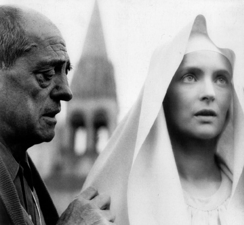 "Luis Buñuel on the set of The Milky Way (w/ Edith Scob in her role as the Virgin Mary) (1969, dir. Luis Buñuel)  ""I gave up being religious as an adolescent. But do you think I no longer retain any elements of my Christian formation in my way of thinking? Among other things, such as sacred music, I can be profoundly moved by a ceremony honoring the Virgin, with novices in their white habits and the purity of their appearance."" (via)"