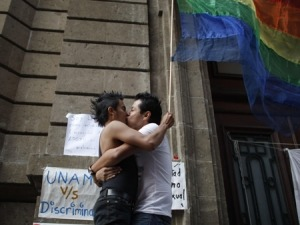 A couple kisses after marriage is equalized in Mexico City, 2009.