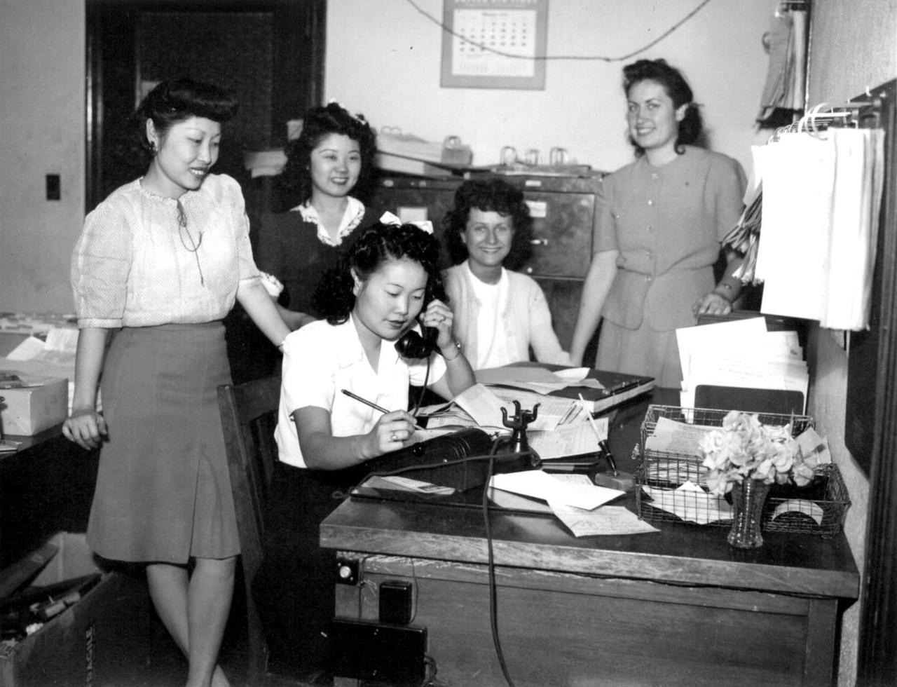 "fuckyeahapihistory:  Mary Kitano from Manzanar and her fellow-workers on the staff of the City News Service, 1945. Mary Kitano just received a $25 check from Readers Digest for a picturesque patter item, and also has a commission to write for Now magazine. City News Service has 15 reporters, covering metropolitan Los Angeles for nearby small-city papers. Photographer: Mace, Charles E. Los Angeles, California. 5/14/45  A 2007 interview with Mary Kitano and her husband, Doug Diltz, plus more photos. PIONEERING ASIAN-AMERICAN JOURNALIST MARY KITANO left a life of incarceration and displacement at Manzanar ""Relocation Camp"" in World War II to return to Los Angeles, where she worked for City News Service, the Daily News, and eventually KNX Newsradio. She and her husband, veteran L.A. wire service journalist Doug Diltz, met when Mary worked in the Daily News libary, and Doug worked for United Press, which was just down the hall in the old Daily News building at Pico and Los Angeles Streets."