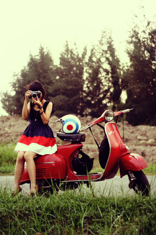 red vespa, black seat
