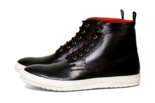 Junya Watanabe Comme des Garçons Man x Trickers Short Boot  The two brands come together again with the latest production of short boot. The style incorporates both boot and sneaker sensibilities with a black  cowhide upper and red lining, together with brogue details accentuate the upper of the sneaker.