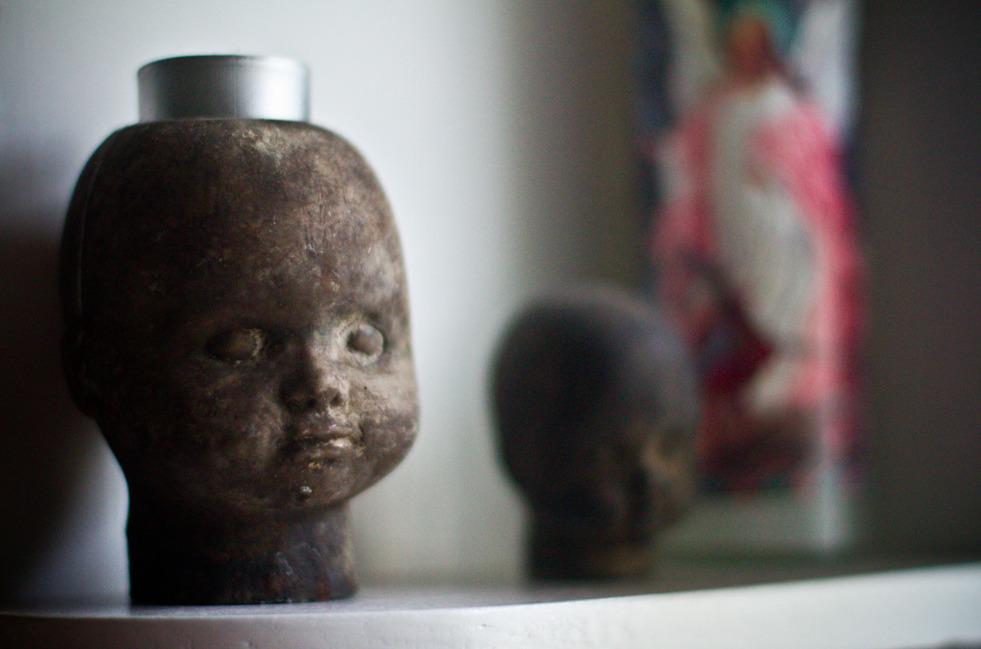 Who needs babies when you have concrete baby-head candleholders? They even have their very own guardian angel.