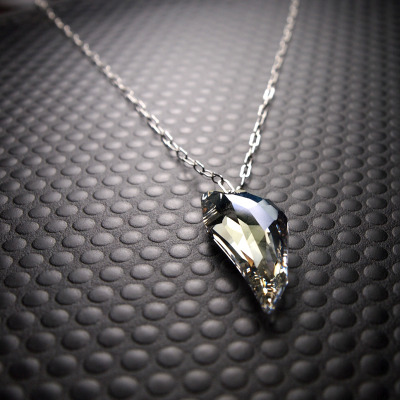 Xyla floating necklace with pegasus crystal in moonlight on argentium sterling silver drawn cable chain.