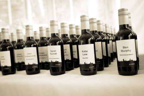 weddingwonder:  The bride and groom used wine with guests' names as place cards and wedding favors.