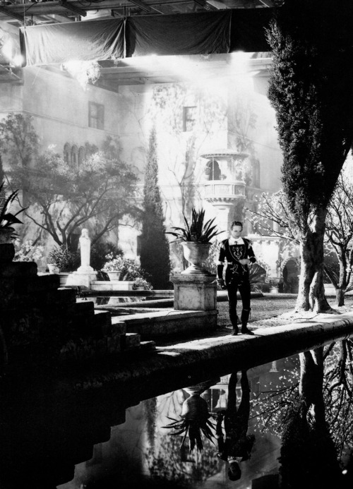 "Leslie Howard on the realized set of Juliet's garden in Romeo and Juliet (1936, dir. George Cukor) Set designer Cedric Gibbons designed the garden so there would be ""a physical obstacle for Romeo to overcome"" on his way to Juliet's balcony. Photo by William Grimes. (via)"