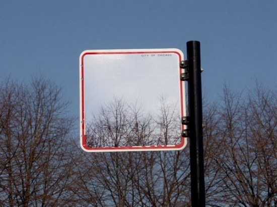 Cayetano Ferrer's clever street art consists of photos placed over signs to make them look transparent. Invisible Street Signs by Cayetano Ferrer