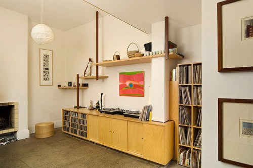 I really love the vinyl set up in this room - including their massive record collection and the beautiful turntable. I can just see myself curled up next to the fireplace with a cup of tea and book by Jane Austen, listening to a little bit of the Black Keys. Um, yes please.  Photo via desire to inspire. As seen on the Miss Moss blog.
