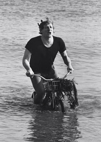 Richard Harris rides a bike. In the water. Singing.