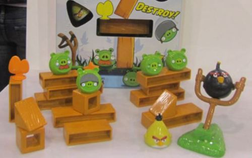 Angry Birds Board Game Coming Soon  We are all great fans of the Angry Birds game which has had record number of downloads across all app stores be it iPhone , Android, Ovi. Now get ready to play this game as a board game this summer.Toy maker Mattel is launching this board game where you can launch the angry birds using a slingshot to take down the pigs. The game also involves cards where players can take turns. The Angry Birds Board game costs about $15 and arrives this May 2011. Fancy getting one of these ?