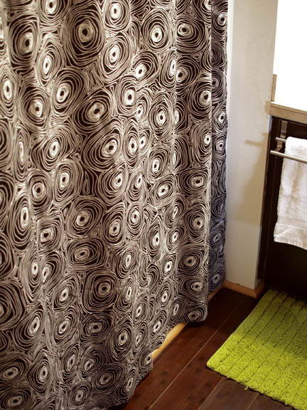 [ QUICK SHOWER CURTAIN PROJECT ] I've been wanting a new shower curtain for our guest bathroom since we moved in a year ago. I nearly bought one last summer, but I couldn't find one that I was completely sold on, so I decided to wait. I don't know why shower curtains have to be so expensive… or ugly. I think I finally found one that I love, but until it goes on sale (like 75% off), I am happy with my newest project. Last week I bought a queen size duvet cover at Goodwill for $6. It turns out that it is an Ikea textile. It seems like anytime I find a modern patterned piece of fabric at a thrift store, it's from Ikea. Turning the duvet into a shower curtain was even easier than when I made one into these curtains. It required very little cutting, which was made even easier by a fantastic new pair of sewing scissors that my mom gave me for Christmas, and hemming on three sides. I think I spent about a little over an hour on this project.  P.S. I really need to get a wide angle lens for my camera!