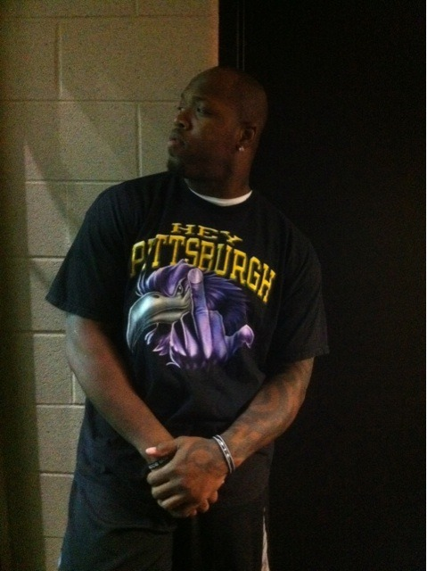 "Terrell Suggs poses in this Steelers ""The bird"" t-shirt"