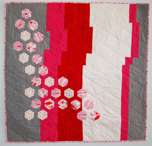 The background is pretty dang interesting. Modern Hexagon Quilt by Reanna Lily Designs, featured on her blog.