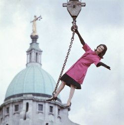 Model Carmen on a crane in front of the Old Bailey, London. Photo by the incredible Norman Parkinson.