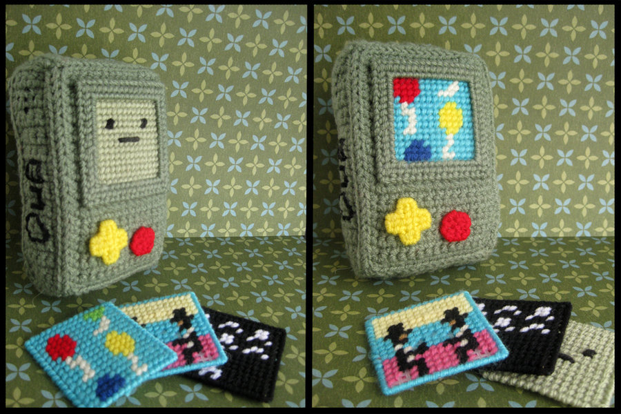 Crocheted Beemo with interchangeable game screens by Hookrat. I love those insertable cards — there's one for Conversation Parade (my favorite!), the Abraham Lincoln fighting game, and the Space Invaders-style shooter. Hookrat hasn't completed this project, hence the missing buttons and limbs, but I can already tell this is something I need in my life. Beemo is like the perfect handheld; I hear it doesn't even have region-locking or a friend codes. Speaking of Adventure Time, I saw the best link ever yesterday: Rhombus TV, a streamlined site hosting every episode from the show's two seasons! It's totally not sanctioned by Cartoon Network, and it doesn't work for everyone (JC wasn't able to load it), but if the site stays up and loads in your browser, you're in for a treat! Buy: Adventure Time merchandise See also: More mathematical Adventure Time posts [Via Albotas, Hookrat]