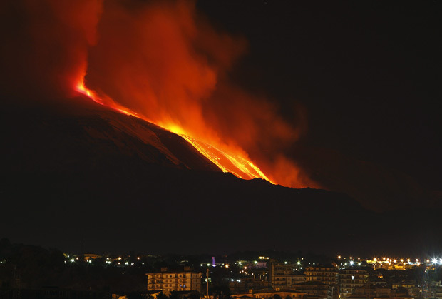 inothernews:  BURN NOTICE   Mount Etna spews lava on the southern Italian island of Sicily. Mount Etna is Europe's tallest and most active volcano.  (Photo: Reuters via the Telegraph)