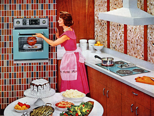 theniftyfifties:  Preparing for the dinner party, 1950s.  Beautiful kitchen!