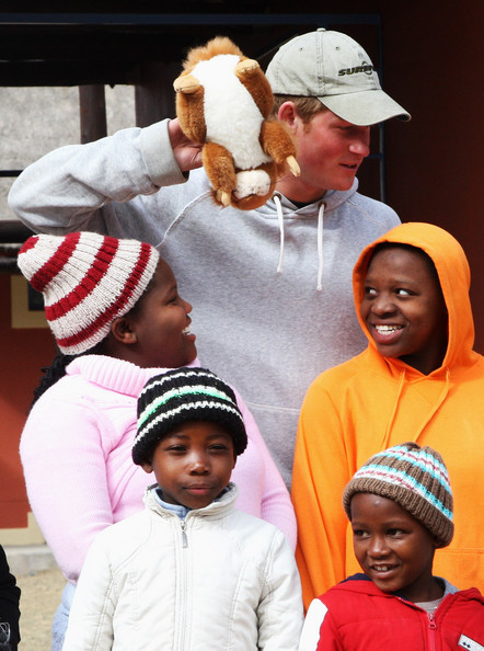 Prince Harry holding a stuffed squirrel PLUS bonus cute African children!