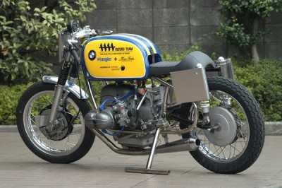 Check out this cool Airhead BMW R69S racer, dual plugged, looks like Mikuni carbs, a huge oil pan extension, a strap on /5 tank & I don't know where the front end came from. A very interesting motorcycle bristling with cool touches.