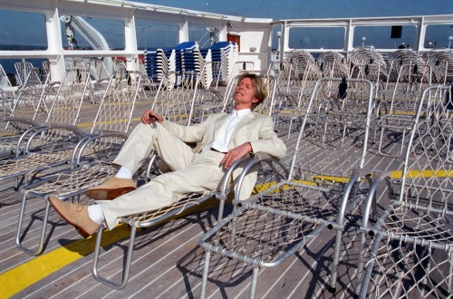 Big photo of posh Mr. B. lounging on the deck of the QE2.