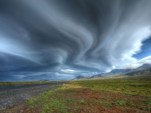 Snæfellsnes Peninsula, Iceland. The clouds look like they're snaking their way out of the photo…which makes you want to snake your way into them.