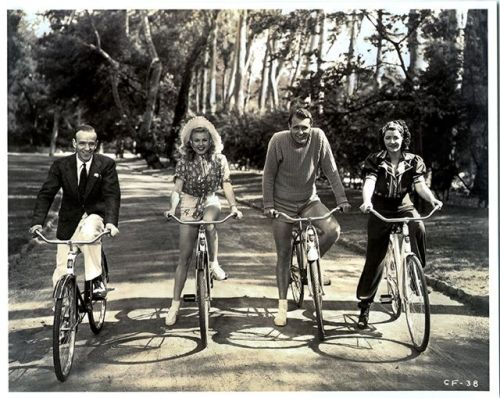 ridesabike:  Fred Astaire, Ginger Rogers, Ralph Bellamy and Luella Gear ride bikes.