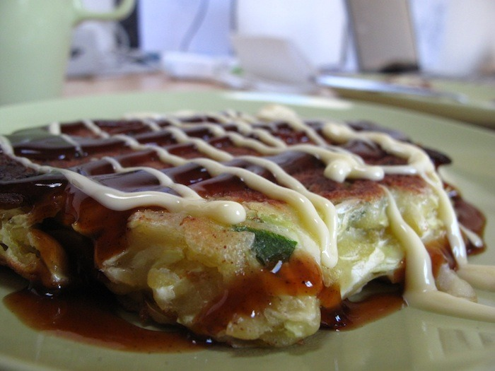 OH! konomiyaki Here is the food that started it all. Two years ago, Foodspotting's co-founder Alexa discovered okonomiyaki while visiting family in Japan. When she returned home, she realized there was no easy way to locate specific dishes, like the ones she'd come across while abroad. And so Foodspotting was born to solve that problem. Seth was kind enough to make us a big okonomiyaki feast for lunch today. This is what it looked like before I demolished it and put it in my stomach.