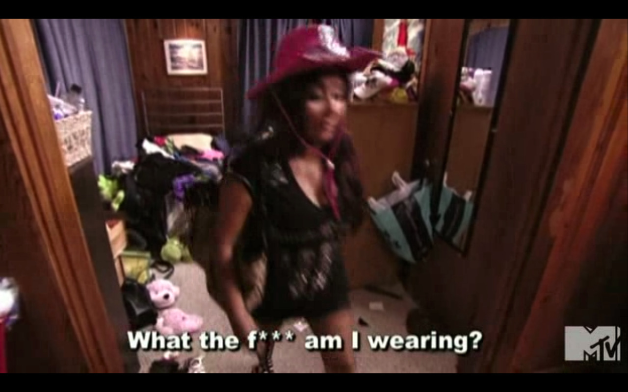 A sparkly cowboy hat, long top, short shorts, mismatched knee socks and flip flops. Obvz.