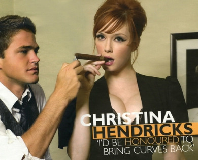 "actress christina hendricks having a cigar lit by a young man, with the quote ""i'd be honored to bring curves back"""