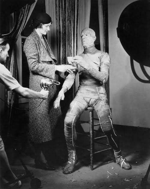 Classic Movie Monsters: Boris Karloff socializes in his Mummy make-up as Jack Pierce puts the finishing touches on him with a blow dryer.