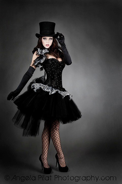 darkness664:  Mmm… top hatted corset girls…