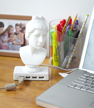 Fancy desk candy.  The ceramic Aphrodite USB hub bust (say that 10 times fast!) from FredFlare.