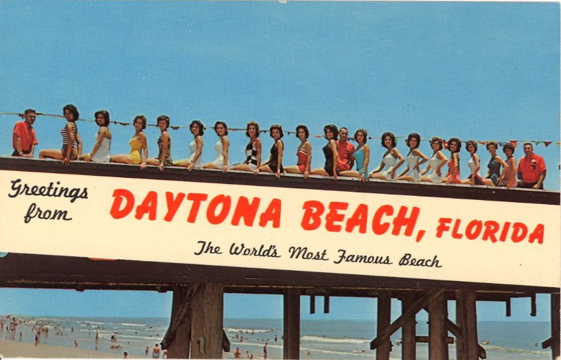 DAYTONA BEACH BATHING BEAUTY LINEUP See the three old guys in red shirts? They are: a) Referees b) Finishing School instructors c) Spiritual counselors d) Something else?