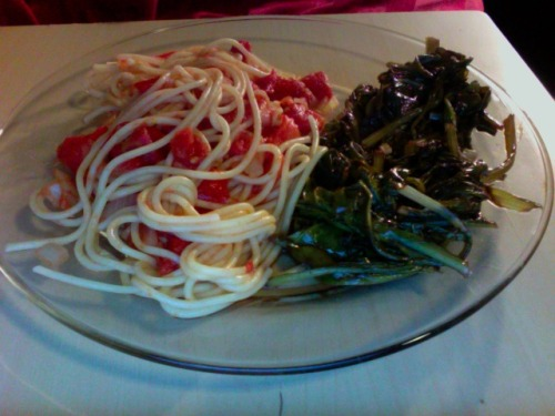 Today's Golden Globe meal: spaghetti with garlic, onion and tomato sauce and sauteed Swiss chard from our garden