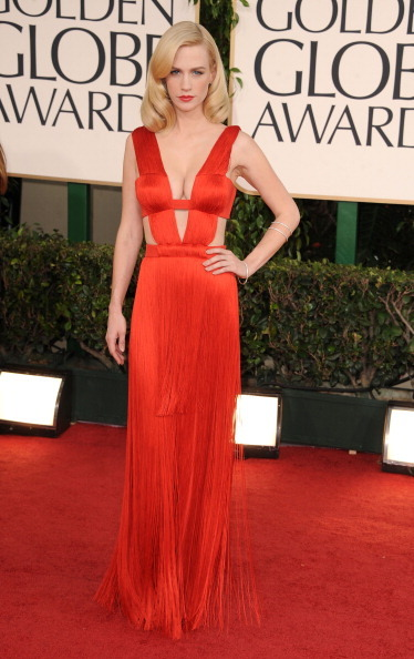 January Jones - Golden Globe Awards, January 16th 2011 January is so thin right now! It's a little startling. Still, she is fiercing up the red carpet like she always does. This fiery shade is heavenly with her pale skin & blonde hair & her boobs look positively inviting.