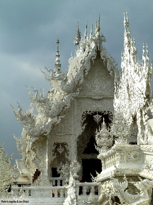 dailybunch:  Wat Rong Khun Buddhist Temple in Chiang Rai, Thailand. As if the amazing exterior weren't enough, inside there's a painting that blends the worlds of The Matrix, Avatar, Superman, Transformers, and other film legend. [via]