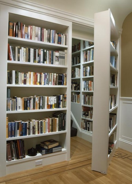 Stairs behind secret bookcase door
