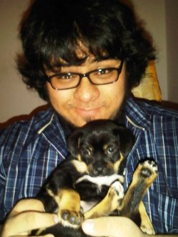 My friend, Michelle, recently got a puppy. That's me and the little rascal right there; his name is Dexter. He's the cutest little thing and I love him.