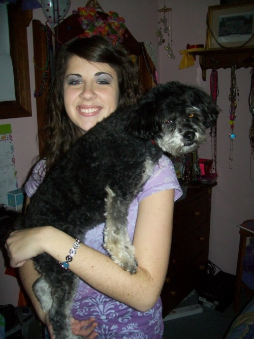 January 16th, 2011  This is a picture of Allie and Gracie.  While we were gone all weekend Allie watched Gracie and made sure she was taken care of.  She's amazing like that. Allie REALLY LOVES ANIMALS.  It's to an extreme, not gonna lie, but I think it's really sweet.  I wouldn't have left her with anyone else.  Gracie really seems to be loving on Allie in this pic…or not.  Once I came to pick her up she got kinda wild and didn't really want anything to do with anyone but me.  Go figure, but thanks again Allie for taking great care of the family dog!