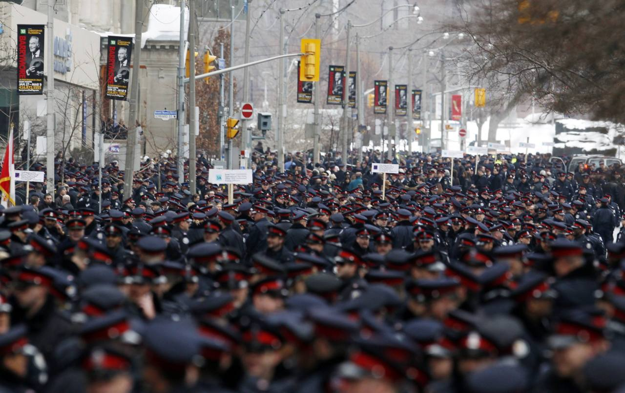 Police Funeral Toronto, Canada nationalpost:  Thousands of police officers line the street as they prepare to march to the funeral service for Toronto Police Sgt. Ryan Russell in Toronto, January 18, 2011. Russell was struck and killed while trying to stop a stolen snow plow earlier this month. (Reuters/Mark Blinch)More: Words and photos from the funeral procession for Sgt. Russell
