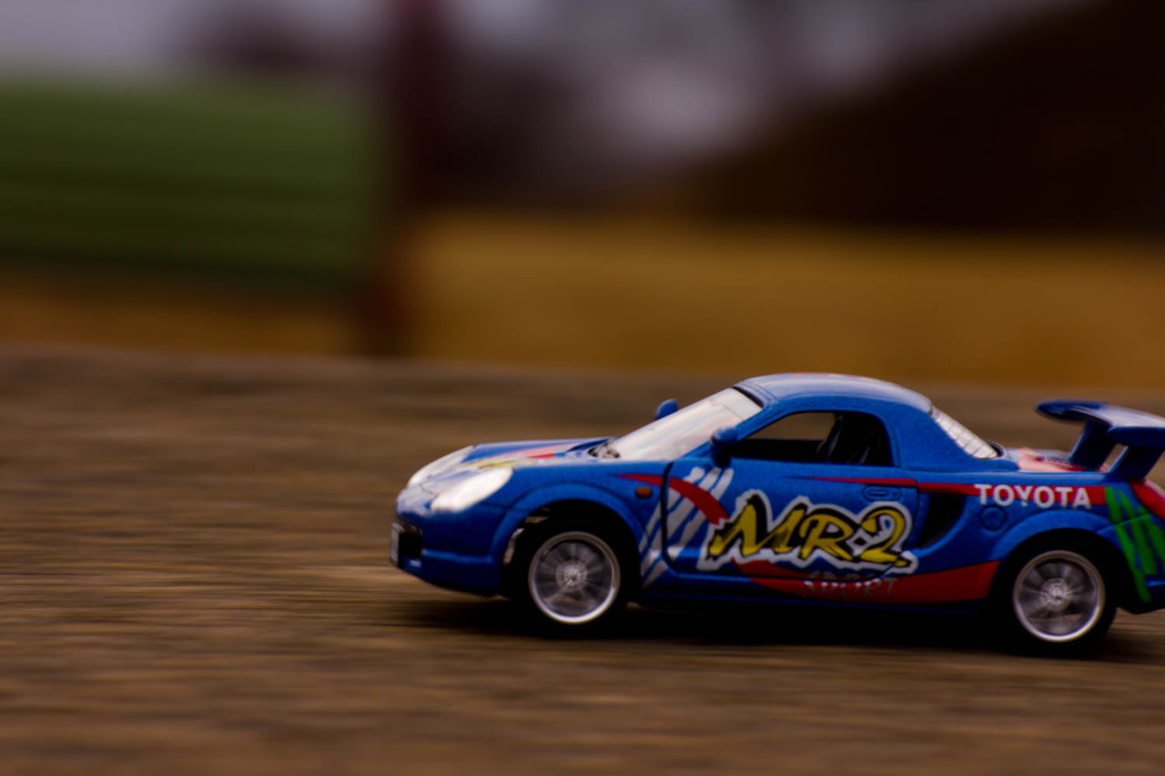 ericmichalskiphotography:  This Is a picture of a toy Toyota MR2 that I took for my 'toy to life' assignment. My girlfriend Christina helped me out a lot with this one, she pulled back the car and then it would take off with its little motor. This was shot with a Canon T2i w/ Sigma 50-200 Thanks for looking, -Eric Michalski