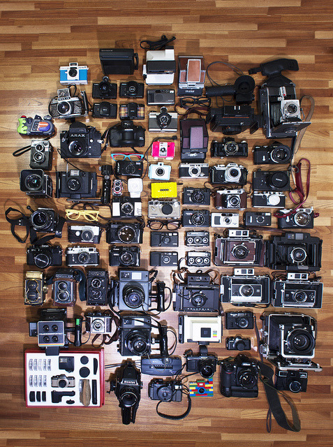 ryancabal:  mijonju:  partial camera collection. (by Michel Jones) closer look here Please reblog my fellow camera lovers :) Photoshop's facebook page did not give me credit for using this photo WHY? :( cries* http://www.facebook.com/photo.php?fbid=491948284684&set=a.121002169684.102742.6147239684   I wonder what his 2012 collection looks like