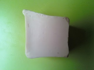 Alkmaar soap is a creamy, white, sexy scented soap from LUSH. My Rating: ★★★★★ 5 out of 5 Stars Scent: coconut + jasmine Price/Size: $7.95 for 3.5oz Recommended for: Anyone Review: Alright, so i know alot of people may not smell coconut in this soap, but thats exactly when I smell every single time. In fact, its a sweeter smelling, less 'smokey',  version of the Coolaulin scent, if you ask me. No, it's not super cute or colorful like other LUSH soaps, but its still amazing. I've desperately been wanting to try I Should Coco or another coconut soap from LUSH but I obviously missed that one, so when I recieved a sample of Alkmaar and thought it smelled sweet, coconutty, and sexy (because of the jasmine and velvert) I was really surprised. This soap is very creamy, but I find that it doesnt waste away as quickly as Sultana of Soap. It lathers well and leaves a very creamy, thick froth. Alkmaar rinses off clean, but leaves your skin lightly moisturized and soft after the shower. Its a really great soap! If you've tried Snowcake or Sultana of Soap and like them because of their creaminess but dont like their scents - try Alkmaar! The only downside is that i wish the scent lingered really long because I love it so much, lol, but it doesnt :( ask | submit