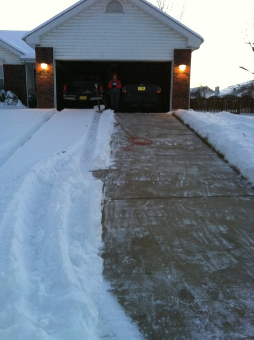 The driveway is shoveled!  Can you tell which one of us drives a 4x4 and doesn't care about a little white stuff?
