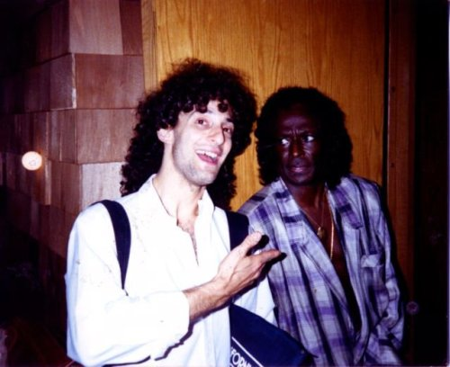 "marathonpacks:  Kenny G, being glared at by Miles Davis on the tour on which the former opened for the latter. (via Kenny G's Facebook page, via Ned Raggett)  Miles: ""Who is this jive-ass turkey?"""