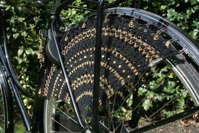 crocheted dress guard for when you're riding your bike in the rain [source]