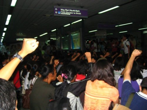 Jan. 14 - Youth activists stage a 'sit-down' protest INSIDE the LRT 2 Legarda station against the up-to 100% MRT-LRT fare hikes. Security guards and the station intercom where unable to drown out the protest and discourage the youths. Anti-fare hike groups like Anakbayan have vowed to mount more actions every Friday until the increases are junked.